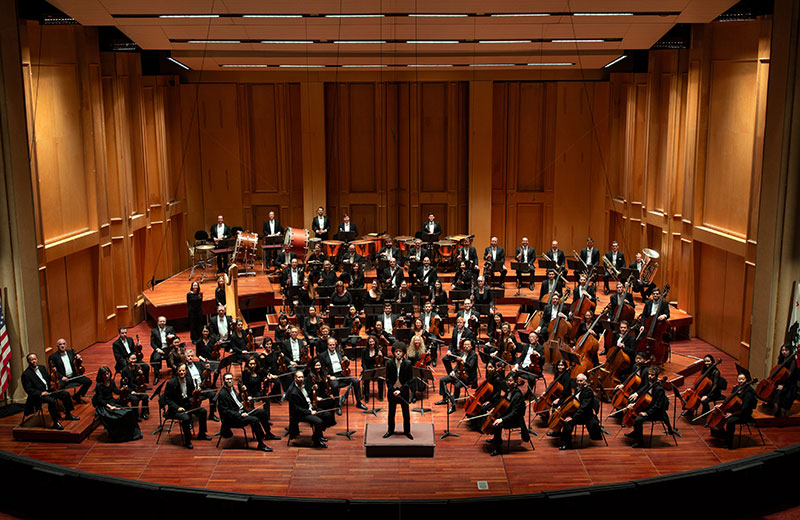 Full San Diego Symphony Orchestra group photo on Copley Symphony Hall Stage