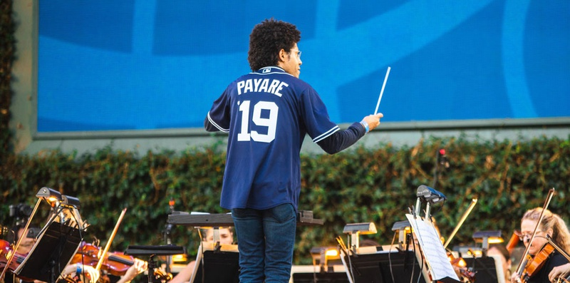Rafael Payere conducts the San Diego Symphony wearing custom Padres jersey at PetCo Park